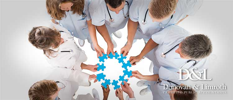 Dental team joining puzzle pieces in a huddle